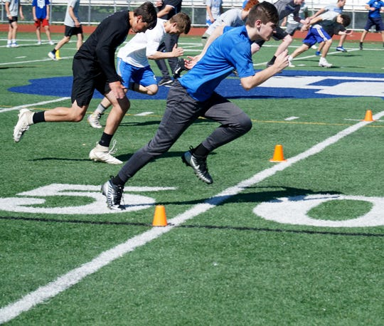 Detroit Catholic Central football players work on some foot agility and speed drills at their Novi campus on June 15, 2020.