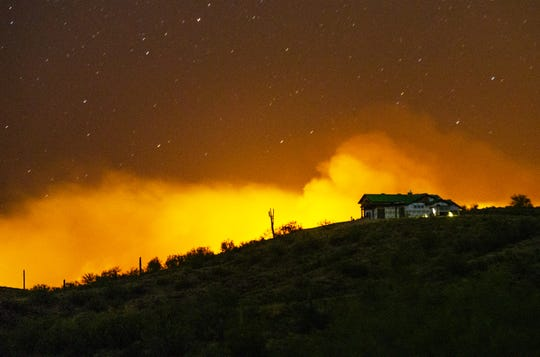 The Bush Fire burns northeast of Phoenix in the Tonto National Forest on June 14, 2020. The human-caused brush fire is burning in the Sugarloaf and Four Peaks Recreation areas.
