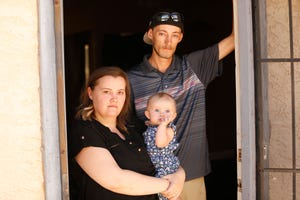 Kaitlyn and Josh Wall with their 6-month old daughter Autumn at their home in Peoria on June 8, 2020. The family has been waiting more than two months for rental help after applying to Arizona's Eviction Prevention Assistance Fund.