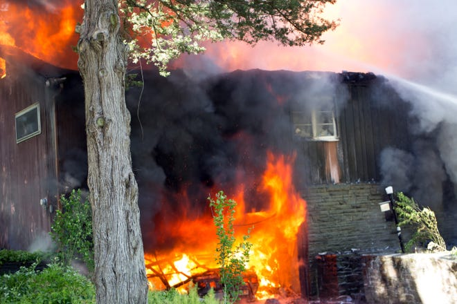 Red Hook Fire Company battles a two-alarm blaze at a Kelly Road residence in the Village of Red Hook on June 15, 2020.
