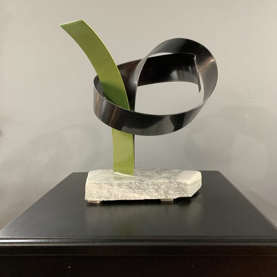 """From the Earth,"" a sculpture by Karen Madden at Queen City 15 Gallery during June."