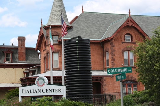 The Christopher Columbus state at the Italian Center in the City of Poughkeepsie is covered with a corrugated tube on June 15, 2020, to protect it from protesters.