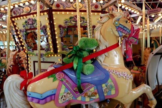 A stuffed animal rides Gigi the horse at the Riverfront Carousel in Salem, Oregon, on Friday, June 12, 2020. The middle row of animals is sectioned off to allow space for social distancing.