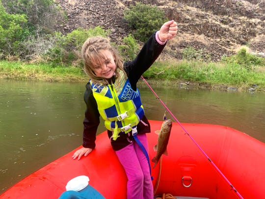 Lucy Urness, 5, after catching one of the many smallmouth bass on the John Day River.