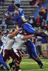 Angelo State's Tyrell McCrea soars to try and block a kick during a game against West Texas A&M.