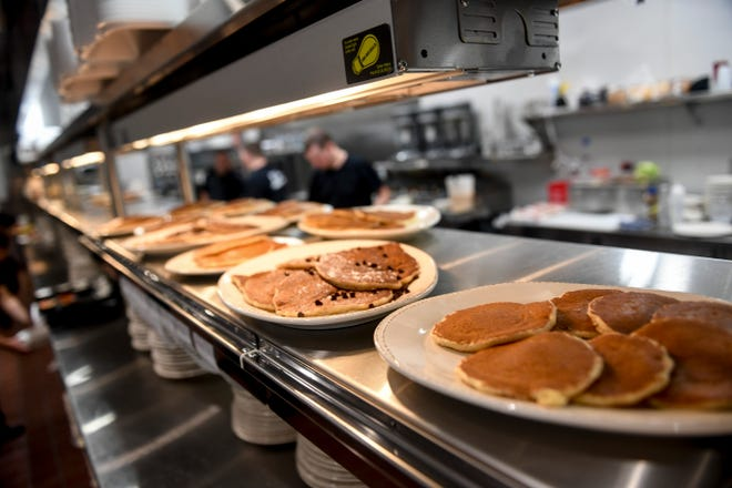 Pancakes sit under a heat lamp on the opening day of The Original Pancake House, on Monday, June 15, 2020 in Sioux Falls, S.D.