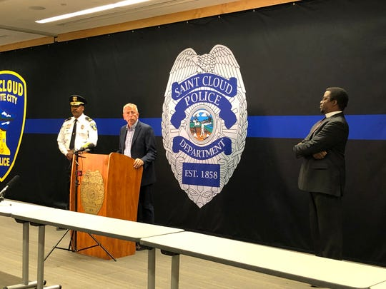 St. Cloud Mayor Dave Kleis speaks at a news conference Monday morning as Police Chief William Blair Anderson looks on. They were addressing the shooting of a St. Cloud police officer in the hand during an arrest early Monday morning.