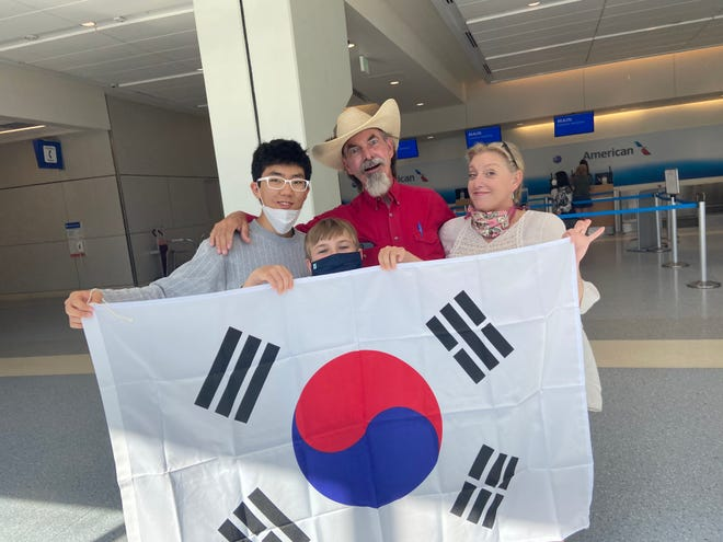 Taike Jang with Wyatt, Tommy and Suzanne Yowell having fun as the leave him at the airport Wednesday after his year exchange in Nocona.