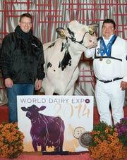 Dan, left, and Paul Siemers holding Siemers Gsun Haya-Dream-ET of Siemers Holstein Farms in Newton, Wis.