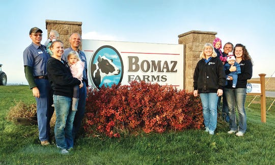 The Zwald Family: Steve holding Abby, Annette holding Katelyn, Bob, Kay, Tom holding Hannah, and Ashley holding Noah. The farm is located in Hammond, Wis.