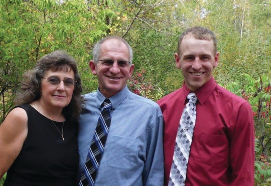 Owners of Hill-ton Holsteins from left, Evie, John and Charlie Hamilton of Cuba City, Wis..