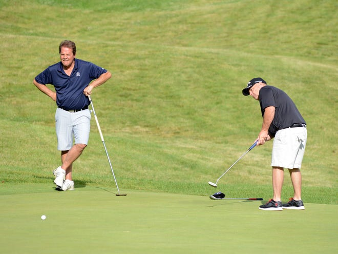 Warsaw native Brad Baker, right, putts on the 16th hole during the second round of the Zanesville District Golf Association Amateur tournament on Sunday at EagleSticks. Baker is tied for the lead after a 1-under-par 69.