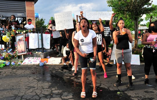 Protesters gather in front of the Wendy's restaurant on June 14, 2020 in Atlanta.