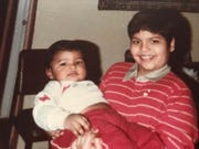 """Ryan Budhu (left) and his brother Dhruvanand """"Ravi"""" Budhu at 真人百家家乐官网网站home in Queens, New York, in 1986."""