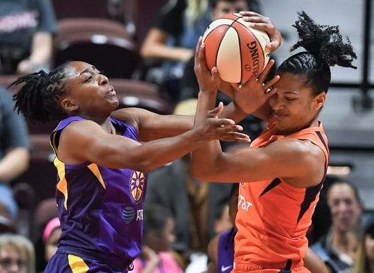The Los Angeles Sparks' Nneka Ogwumike, left, the Connecticut Sun's Alyssa Thomas and the rest of the WNBA's players and teams will return to action at IMG Academy in July, the league announced Monday.