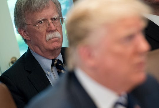 (FILES) In this file photo taken on May 9, 2018, US President Donald Trump speaks alongside National Security Adviser John Bolton (L) during a Cabinet Meeting in the Cabinet Room of the White House in Washington, DC. - Bolton alleges in a book draft that US President Donald Trump wanted to freeze Ukrainian military aid until Kiev investigated his political rivals, The New York Times reported on January 26, 2020. Democrats quickly seized on the report to press demands that Bolton and other key people in the Trump administration be called testify in Trump's impeachment trial. Citing Bolton's unpublished manuscript, The Times wrote that Trump told Bolton he wanted to keep frozen $391 million in aid to Ukraine, until Kiev officials helped with a probe into his Democratic rival Joe Biden. (Photo by SAUL LOEB / AFP) (Photo by SAUL LOEB/AFP via Getty Images) ORIG FILE ID: AFP_1OF3BO