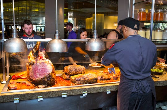 Guests line up at the meat-cutting station at the Bacchanal Buffet inside Caesars Palace in Las Vegas in March.