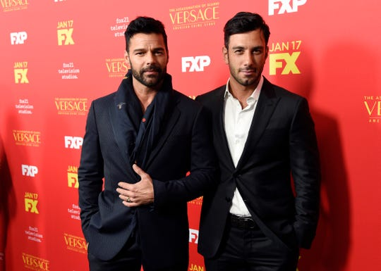 Ricky Martin, left, and husband Jwan Yosef walk a red carpet together in Los Angeles in 2018. The couple is quarantining at 真人百家家乐官网网站home with their four kids during the coronavirus pandemic.