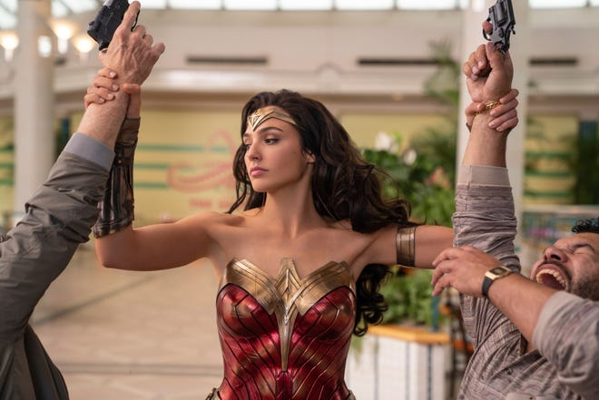"""Superhero sequel """"Wonder Woman 1984,"""" starring Gal Gadot, is one of the upcoming DC movies being highlight at an upcoming Warner Bros. virtual fan event."""