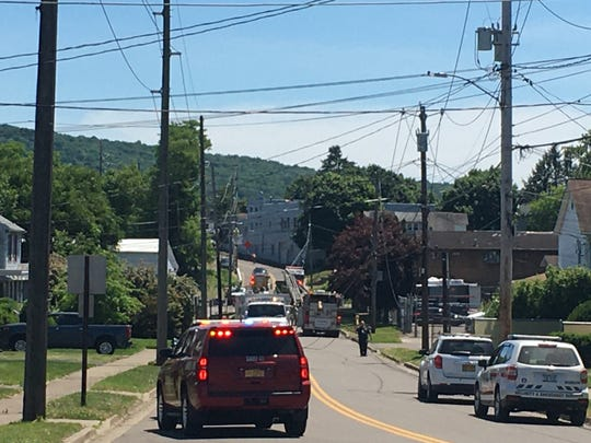 A truck driver escaped injury Tuesday, June 16, 2020 after he was briefly trapped by live wires yanked down by his vehicle, setting off transformer fires on Kentucky Avenue in Endwell.