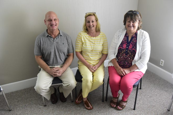 Sitting inside one of the group therapy rooms at the A New Day outpatient addiction treatment facility in Bucyrus are, from left, Craig Holtz, Sarah Olenik and Laurie Korbas.