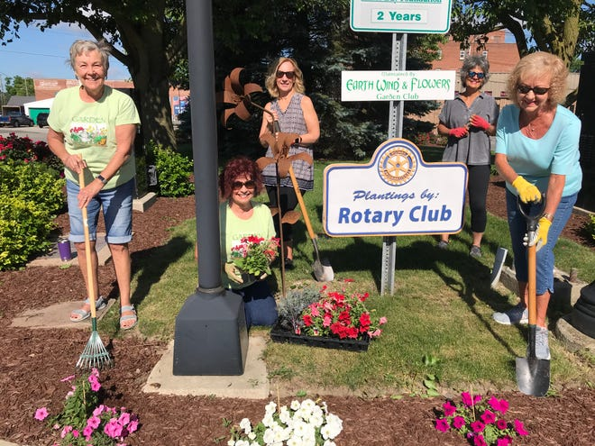 On a morning with cool air and abundant sunshine, some of the members of Earth, Wind and Flowers Garden Club check back on the plantings on the west side of Washington Square here in Bucyrus. They are (L-R): Diane Moore, Shirley Chapman, Beckie Hieber, Susan Maynard and Marylyn Strang.