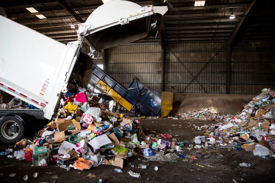 Corpus Christi Solid Waste recycling truck dumps a load of recycling at Republic Services recycling center on Tuesday, June 16, 2020.
