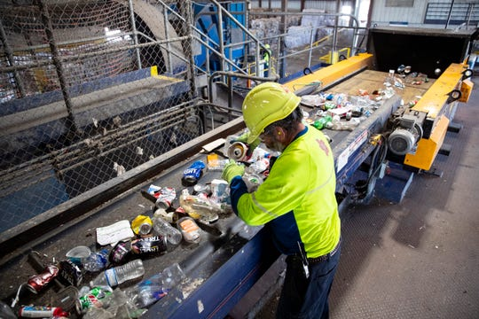 An employe at Republic Services recycling center sorts recyclable materials on Tuesday, June 16, 2020.