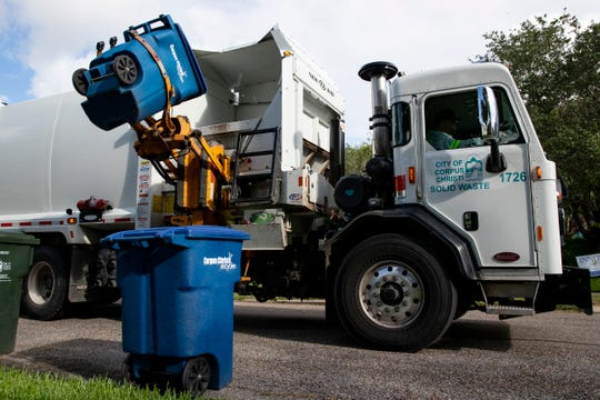 Corpus Christi Solid Waste recycling truck picks up a recycling bin on Tuesday, June 16, 2020.
