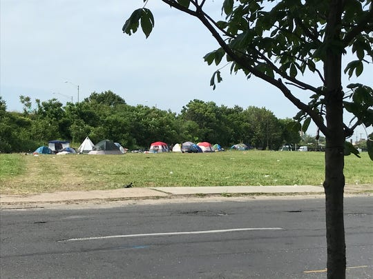 A homeless encampment sprung up several weeks ago on Kaighn Avenue in South Camden. Neighbors are concerned about trash, drug use and human waste around it.