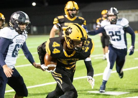Cruz McFadden runs the ball down the side of the football field during a Division VI regional quarterfinal game on Friday, Nov. 8, 2019 in Bainbridge, Ohio.