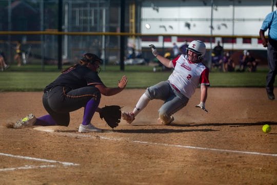 Des Moines East's Narissa Randolph slides into third base during a game against the Johnston Dragons on June 15, 2020 at East High School in Des Moines.