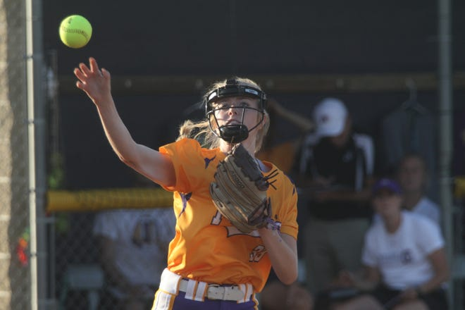 Indianola junior pitcher Kate Kralik throws out a Newton runner at first base. Indianola hosted Newton in the June 15 season opener, winning the game 9-0.