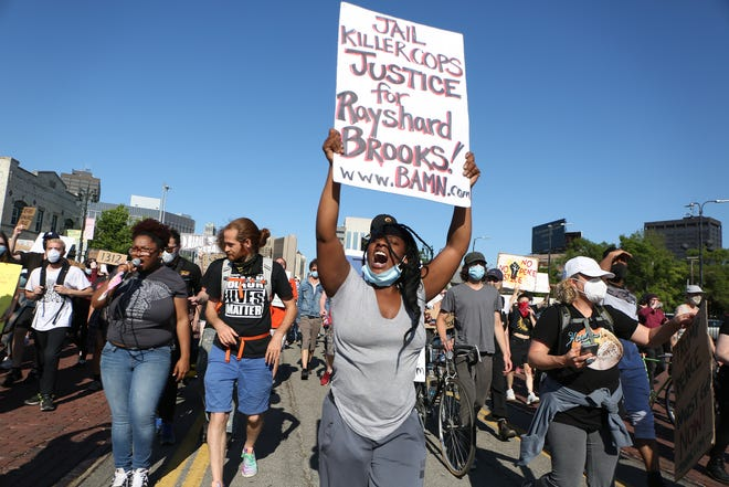 Protesters march down Michigan Avenue on the 18th straight day of protesting on Monday, June 15, 2020.