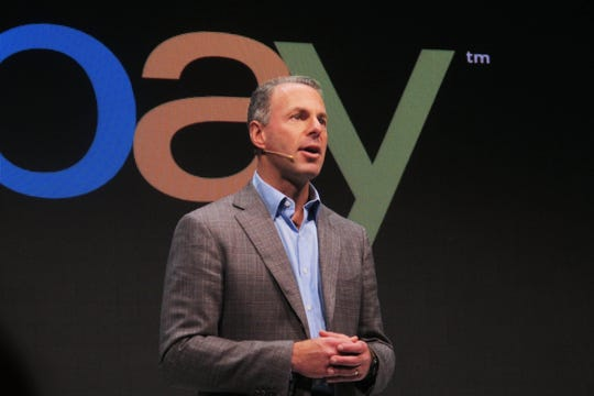 Devin Wenig, president of eBay marketplaces speaks at a news conference in Berlin on Sept. 26, 2013.
