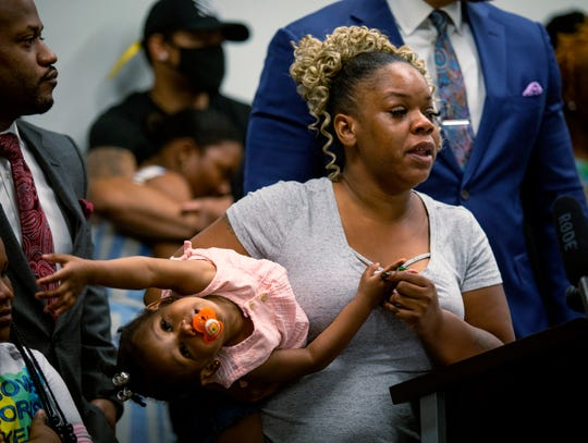 Tomika Miller, the widow of Rayshard Brooks, speaks at a news conference on Monday, June 15, 2020, in Atlanta.