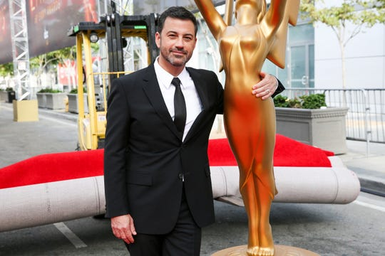This Sept. 14, 2016 file photo shows host Jimmy Kimmel posing for a photo with a replica of an Emmy statue at the Primetime Emmy Awards Press Preview Day in Los Angeles. Kimmel will return as host and will serve as executive producer for the 72nd Emmy Awards. The show will be broadcast, Sunday, Sept. 20, on ABC.
