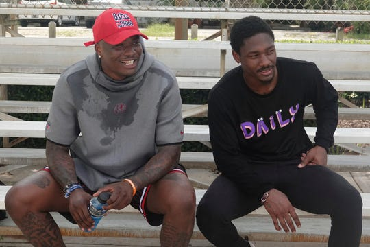 Washington quarterback Dwayne Haskins, left, sits with the Bills wide receiver Stefon Diggs during an offseason workout in Fort Lauderdale, Fla.