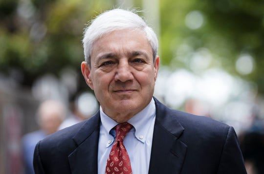 In this June 2, 2017, file photo, former Penn State President Graham Spanier departs after his sentencing hearing at the Dauphin County Courthouse in Harrisburg, Pa.