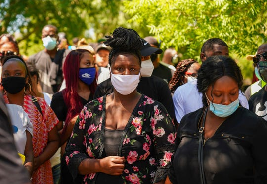 Angel Fuller, center, and Diamond Alexandria, right, Robert Fuller's sisters, attended a rally under a tree, left, Saturday, June 13, 2020, where the body of Robert Fuller was found hanging from a tree.