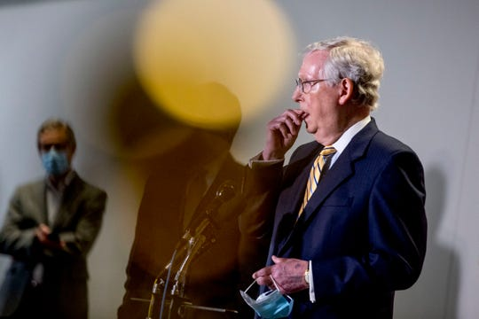 Senate Majority Leader Mitch McConnell, R-Ky., pauses while speaking at a news conference following a Senate policy luncheon on Capitol Hill, Tuesday, June 16, 2020, in Washington.