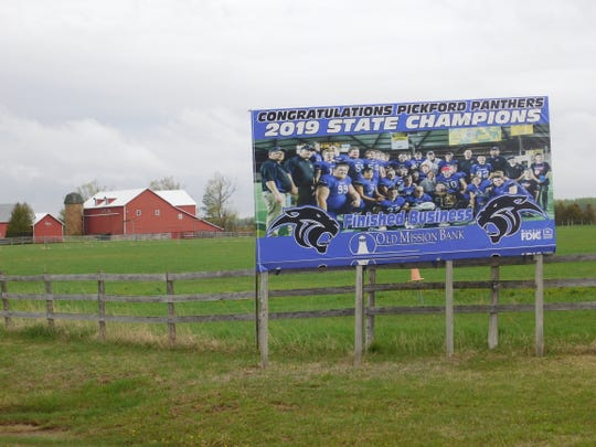 Residents are proud of the Pickford Panthers' title in eight-man football.