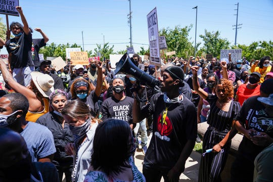Protesters march, Saturday, June 13, 2020, in Palmdale, Calif. to demand an investigation into the death of 24-year-old Robert Fuller.