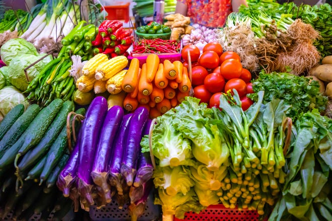 Fresh vegetables and fruits at local market.