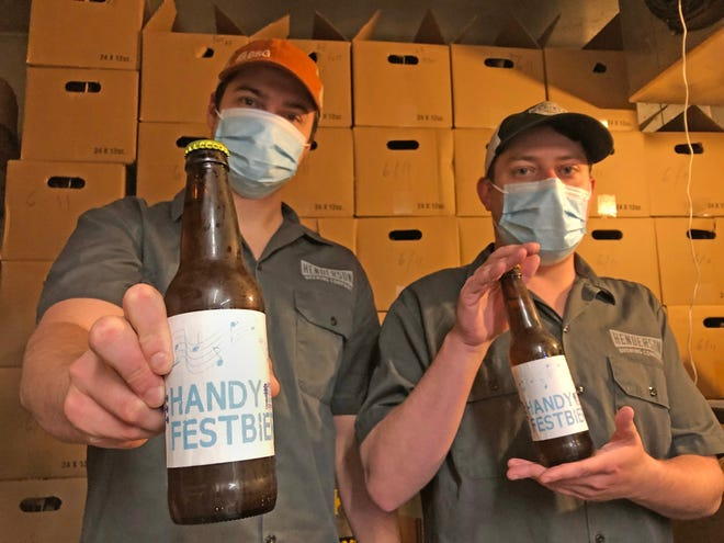 From inside the packed cooler at Henderson Brewing Co., Zach Sohne, left, manager of the tap room, and brewer Matt Watson display bottles of Handy Festbier, a pale lager specially brewed to coincide with the W.C. Handy Blues & Barbecue Festival. With the live festival canceled by the coronavirus pandemic, Henderson Brewing is participating in Handy to Go this Wednesday through Friday, a virtual festival that includes carryout sales of the special brew; carryout sales of barbecue from The Tom's Smokin' Bar-B-Q food truck at the brewery; and a QR code link to songs on Spotify by blues artists who had been scheduled to perform at Handy this year.