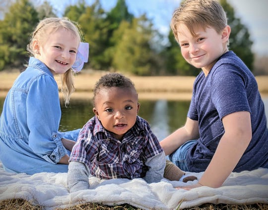 The three children of Matt and Marie Brunet - Madeline, Maverick and Maddox - hope to bring Maverick's birth brother home next week to join the family.