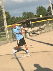 Rod Rodriguez hits the ball during a 65-and-older Marion Senior Softball Association game Monday at Kennedy Park.