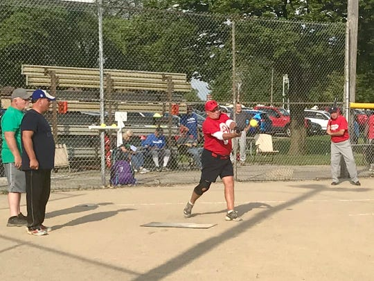 Mike Gist hits the ball during a 65-and-older Marion Senior Softball Association game played Monday night at Kennedy Park.