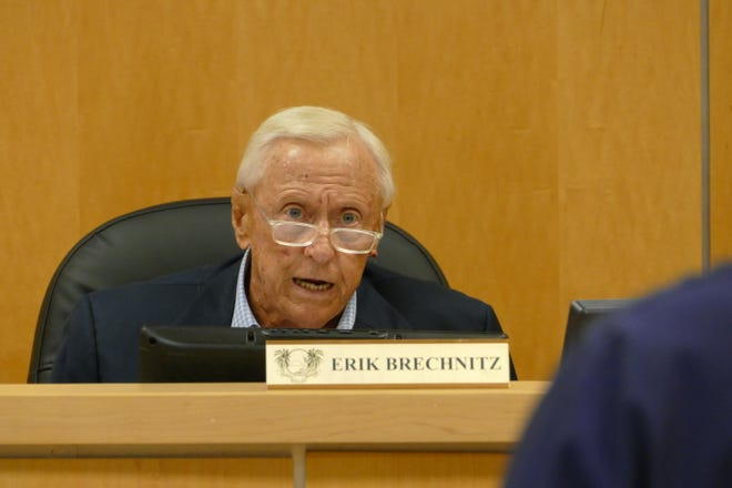Marco Island City Council Chairman Erik Brechnitz speaks to Chris Byrne,  the city's emergency management coordinator, during a council meeting on June 15, 2020.