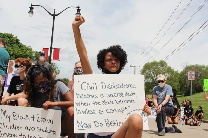 Protesters blocked traffic on Riverside Drive in Beloit.